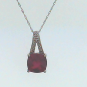 Cushion Ruby 9 Round Diamonds .03 Carat Total Weight 14 Karat White Pave Pend with Chain